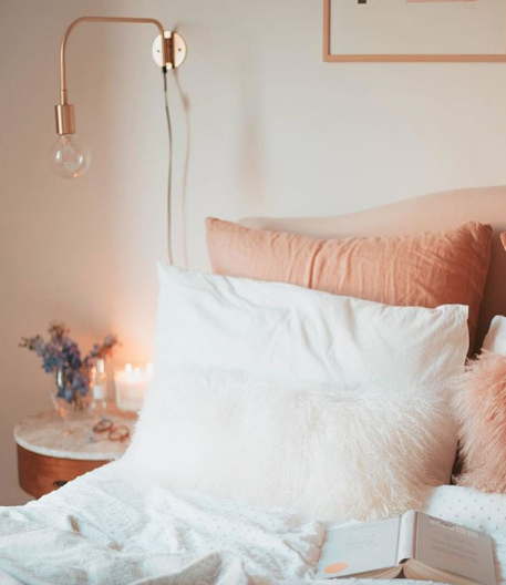 Pink bedroom with mid century furniture