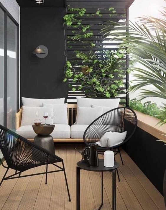 Balcony with black feature wall and outdoor furniture