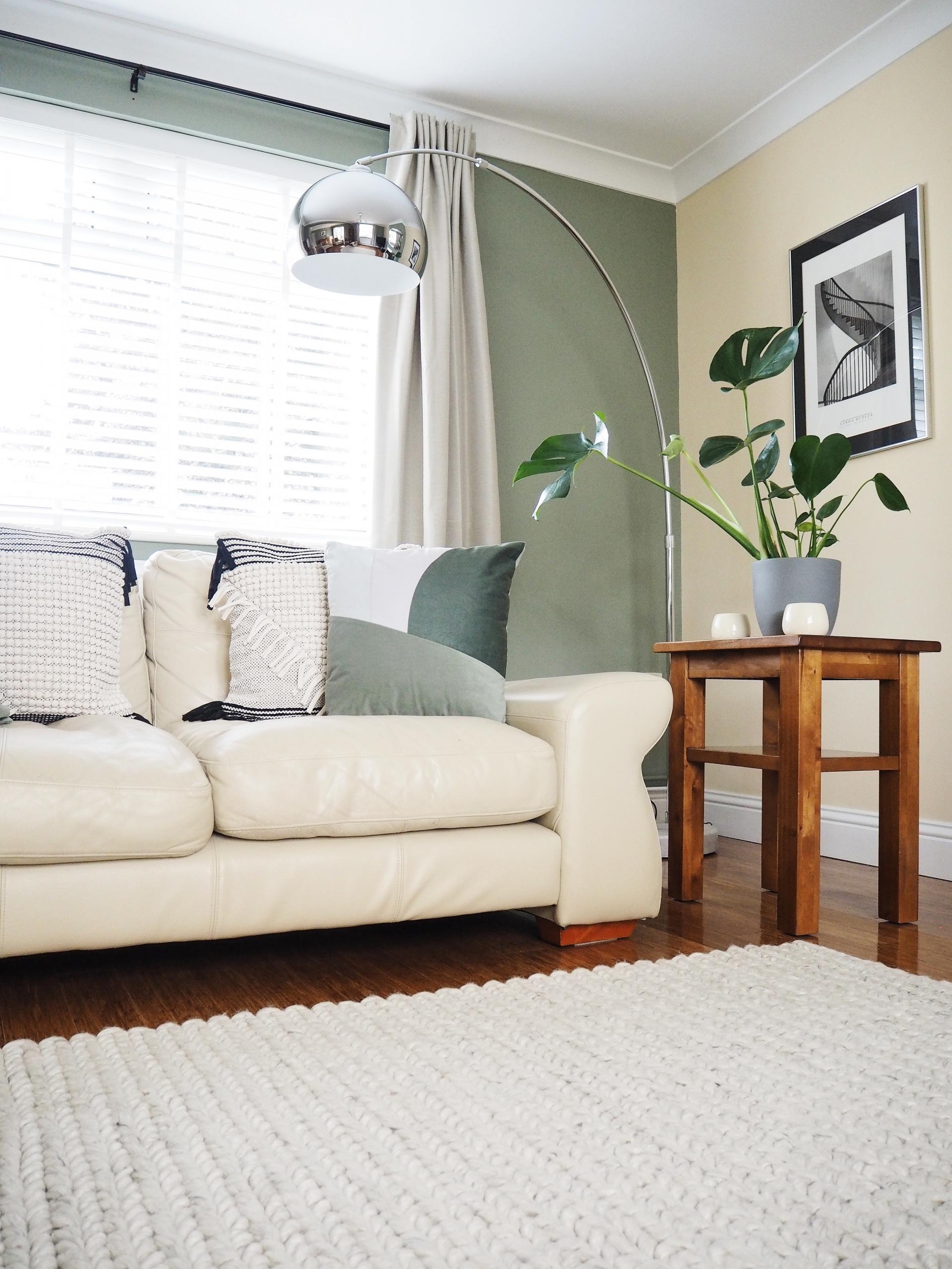 green living room beige sofa